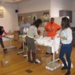 Student Volunteers Prepackaging Thanksgiving Meal